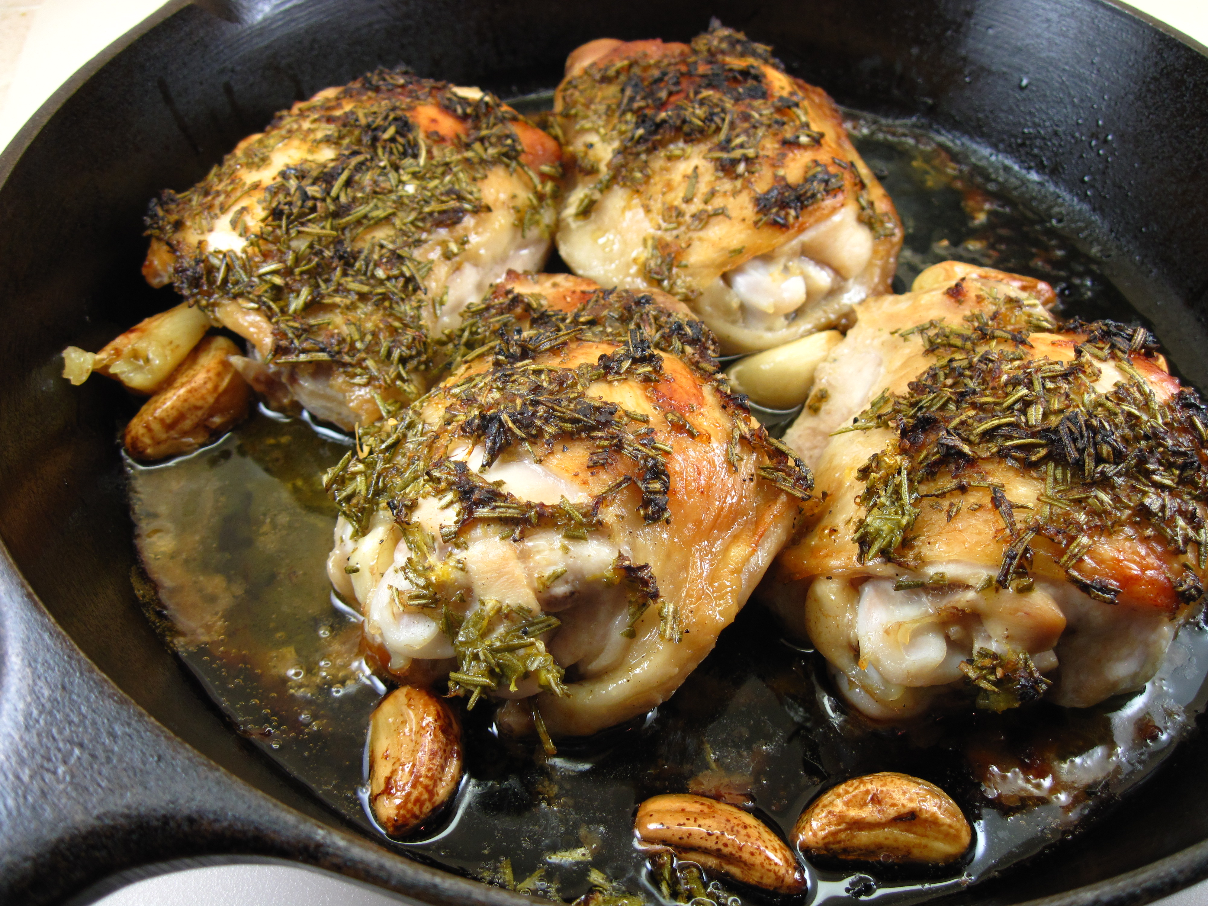 roast lemon garlic chicken with green olives in the kitchen with