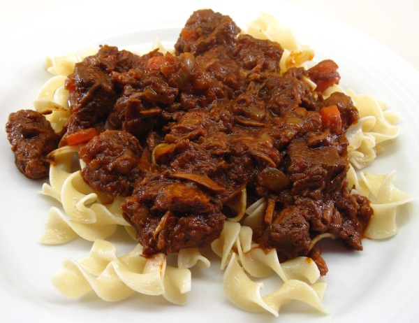 Hungarian Beef Stew served over noodles