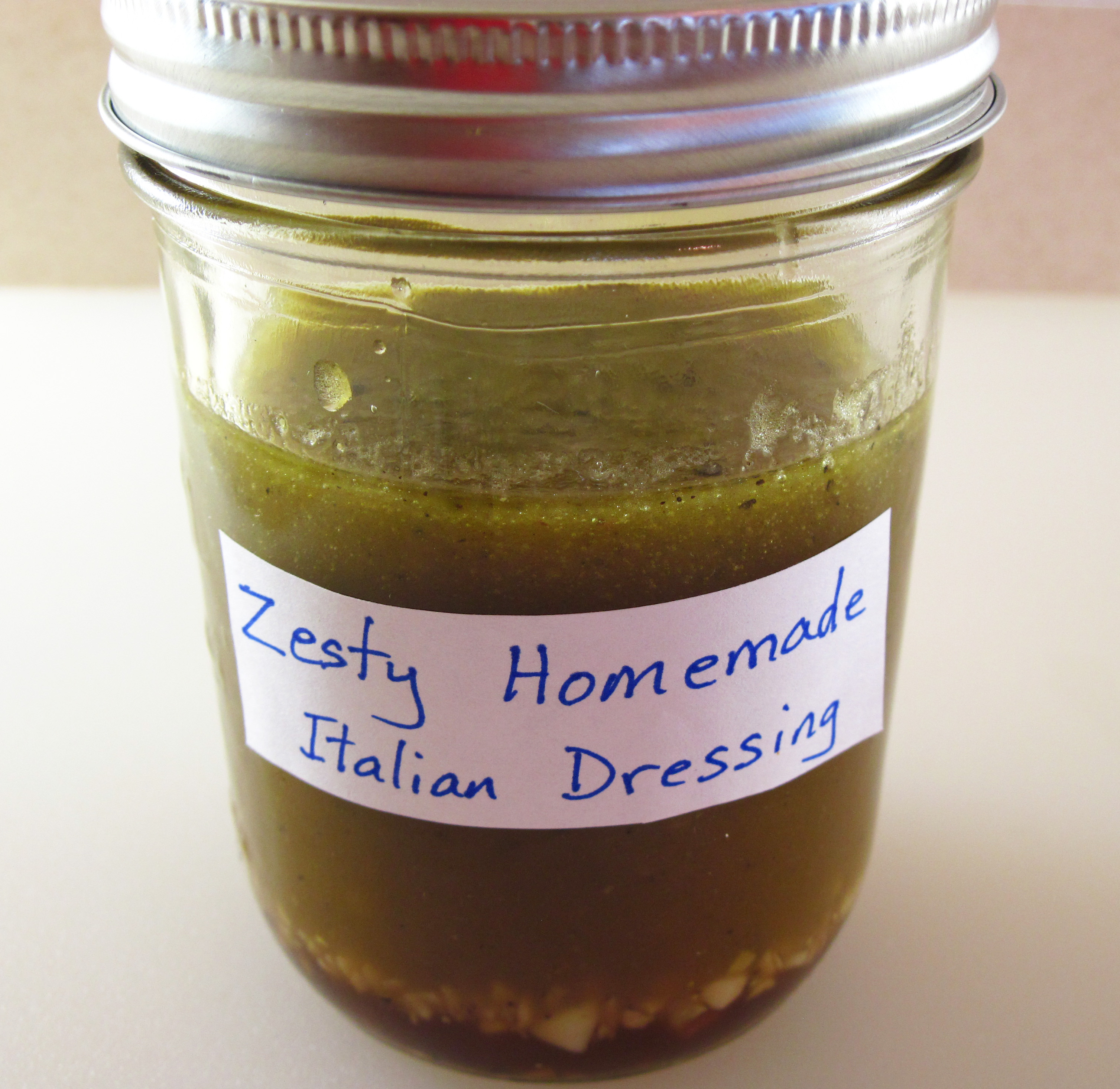 Zesty homemade italian salad dressing in the kitchen Dressing a kitchen