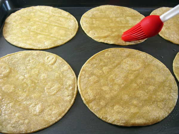 Brushing tortillas with oil