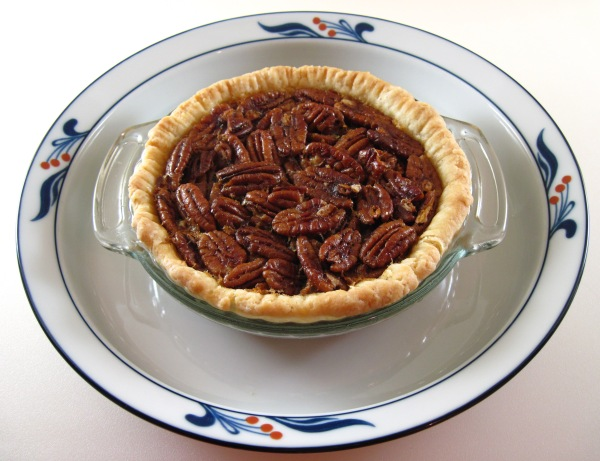 Pecan Pie sitting in a 9-inch plate