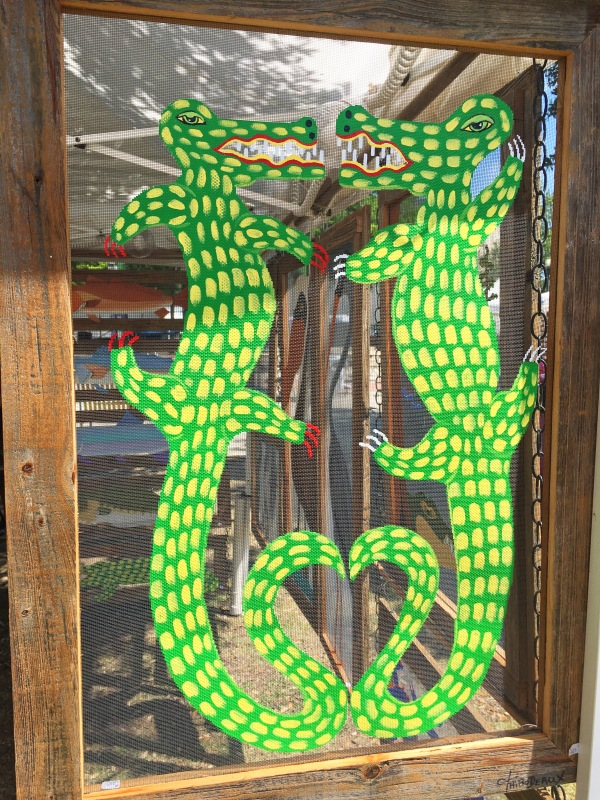 Alligators painted on a screen.jpg