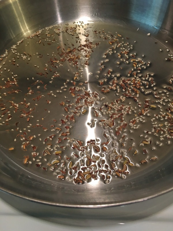 Fennel seeds, cumin seeds, and sesame seeds